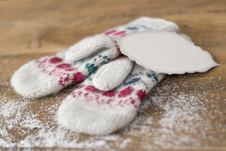 mittens: beautiful knitted mittens on a wooden background