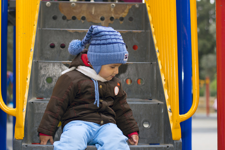 2 years old: boy 2 years old on the Playground in the cooler months