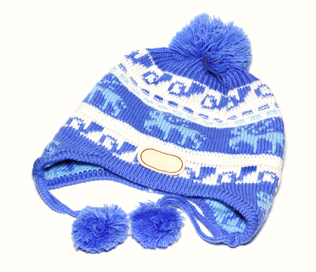 Close-up Of White Knitted Winter Ski Wool Hat With Pom-Pom And ... d7ee5a3f45e5