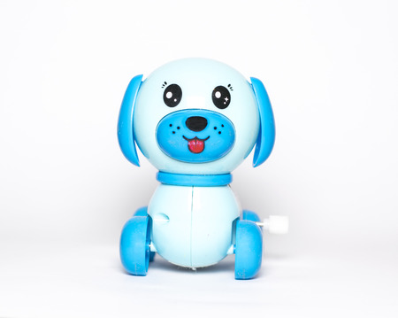 windup: toy dog with wind-up mechanism on white background