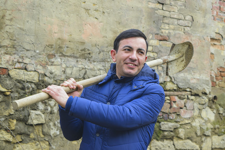 zealous: country young man with a shovel in his hands Stock Photo