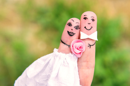 paramour: Funny men painted on the fingers. Newlyweds. Wedding Stock Photo