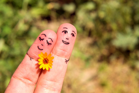 paramour: Drawn on the fingers of men with a flower. The concept of Dating. Family. Relationship