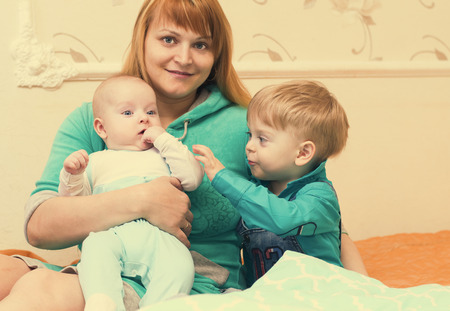 Happy mother of two children at home