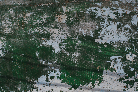 texture of old surface with green and white paint