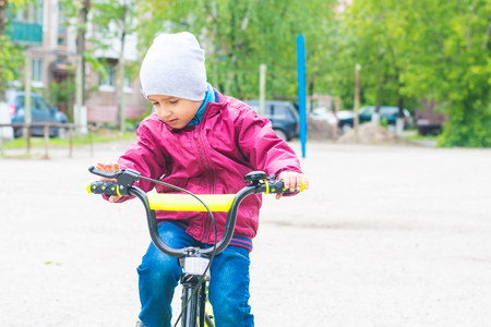 the boy learns to ride a bike Stock Photo