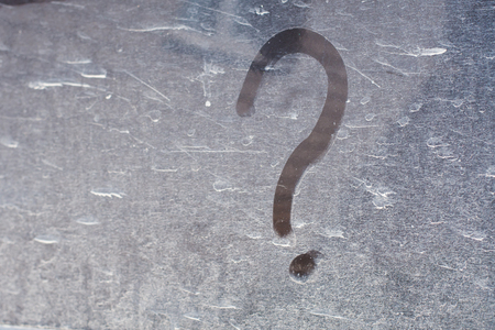question mark on dirty dusty surface. Concept