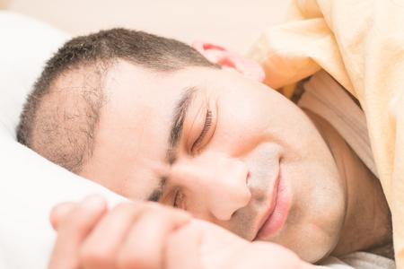 sleeping man in the morning