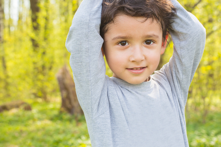 portrait of a boy of 4 years old on a natural background Stock Photo