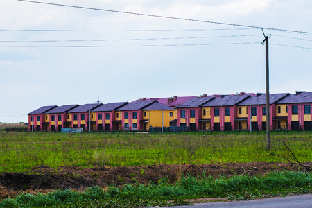 range  of houses among the field. cottage settlement