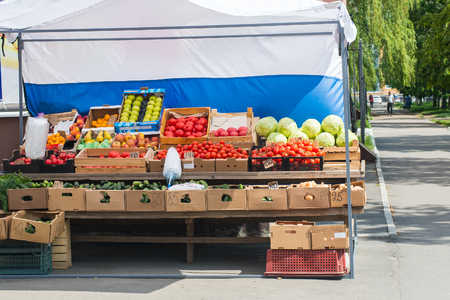 shelf with vegetables in a rack on the street   Stock Photo