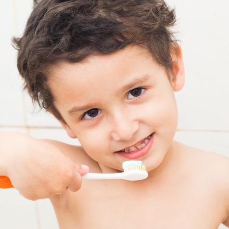 boy 4 years old brushing his teeth