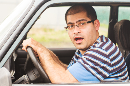 young man with the fear of traveling by car