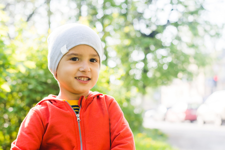 portrait of a smiling boy in a hat in the summer outdoors Stock Photo
