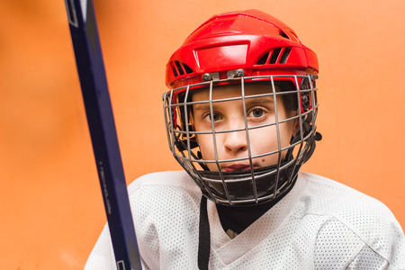 young hockey player in uniform in training