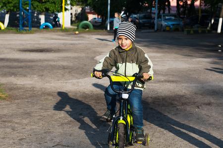 boy riding a bike in the yard