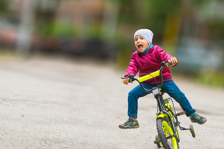 emotional boy learning to ride a bike