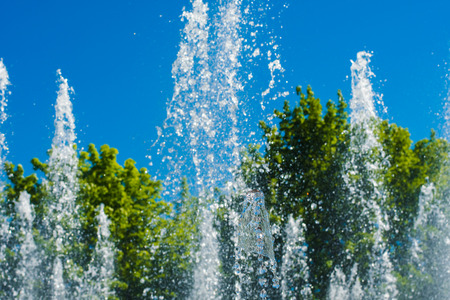 Spray from the fountain on a hot summer day