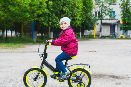 The boy learns to ride a bike