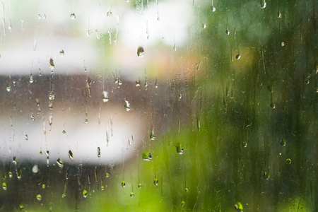rain drops on the window pane in summer