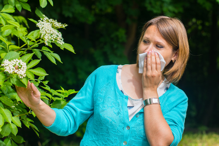 young woman outdoors. Allergy to pollen Stock Photo