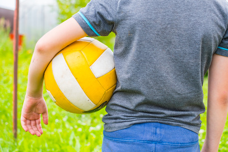 boy with the ball in his hands