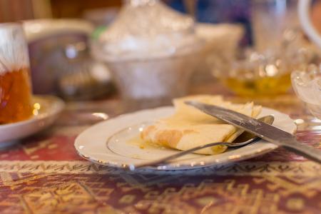 Breakfast on the table. Empty plates on the table. Tea half drunk
