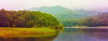 Goygol lake in the mountains in Azerbaijan. toned Stock Photo