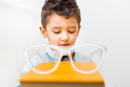 boy and book with glasses. vision concept Stock Photo