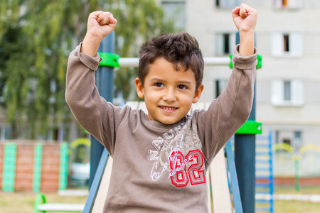 boy on the Playground, outdoors Stock Photo