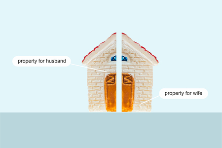 The concept of division of property. The house is divided into 2 halves Stock Photo