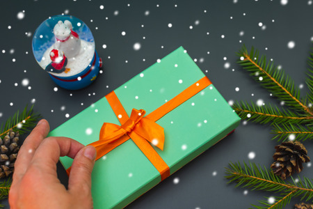 christmas inspiration. Unties the ribbon on the gift box Stock Photo