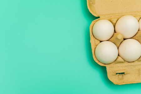pack of chicken eggs on blue background Stock Photo