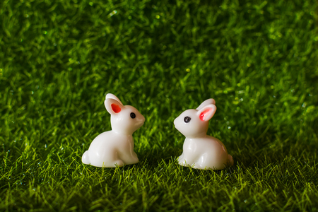 two figures Bunny on the grass. Happy Easter concept