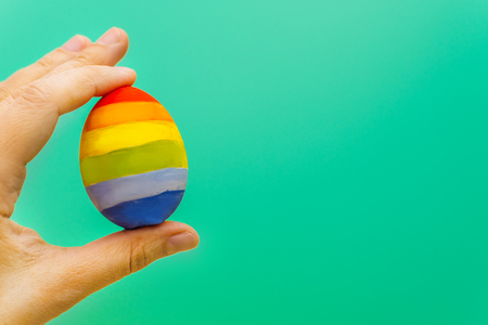 concept of LGBT. colorful egg in hand
