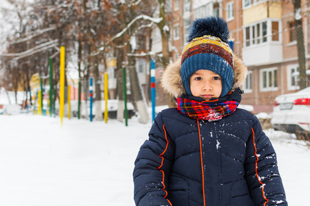 boy walks in the winter outdoors Stok Fotoğraf