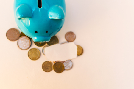 piggy Bank with coins on a light background with a place for the inscription Stock fotó