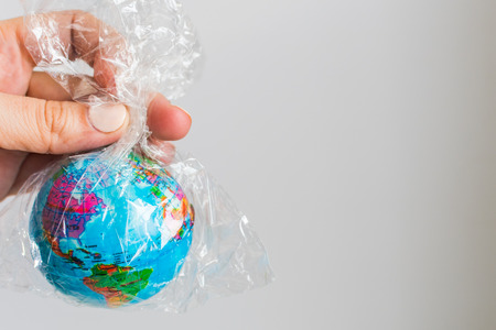 small globe of Earth in a plastic bag. The concept of the pure Earth Stockfoto