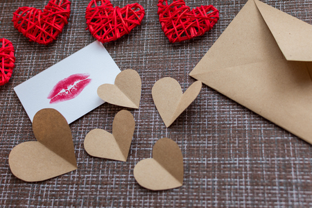 Kraft envelope, hearts and card with a lip print. the concept of Valentines day Stock Photo