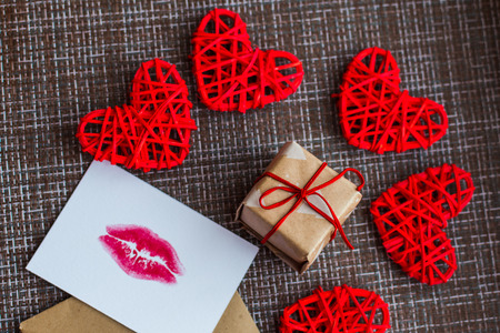 Kraft envelope, gift, hearts and card with a lip print. the concept of Valentines day Stock Photo