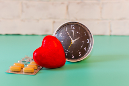 watch, pills and heart shape. the concept of caring for the heart Stock Photo
