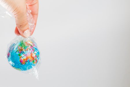 small globe of Earth in a plastic bag. The concept of the pure Earth Stock Photo