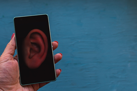 concept of wiretapping smartphones.ear on the phone screen