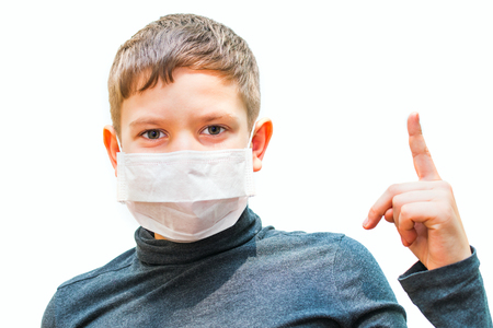teen boy in medical mask shows gesture. isolated background