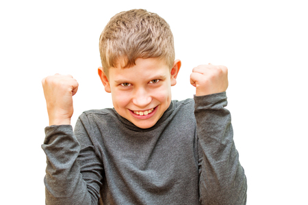 teenage boy. gestures victory. on white isolated background Stock fotó