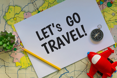 concept of travel. Map, compass and notebook with the inscription Archivio Fotografico