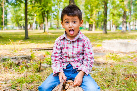 boy fooling around on a walk in the Park Stock Photo