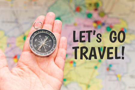 compass in hand. concept of travel