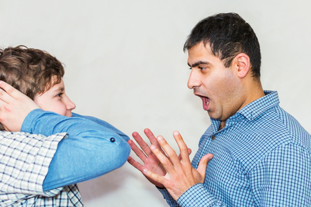 misunderstanding in family. teenage problems. dad and son yelling at each other Banque d'images - 125071907