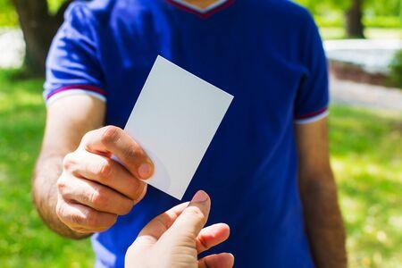 man giving a blank card